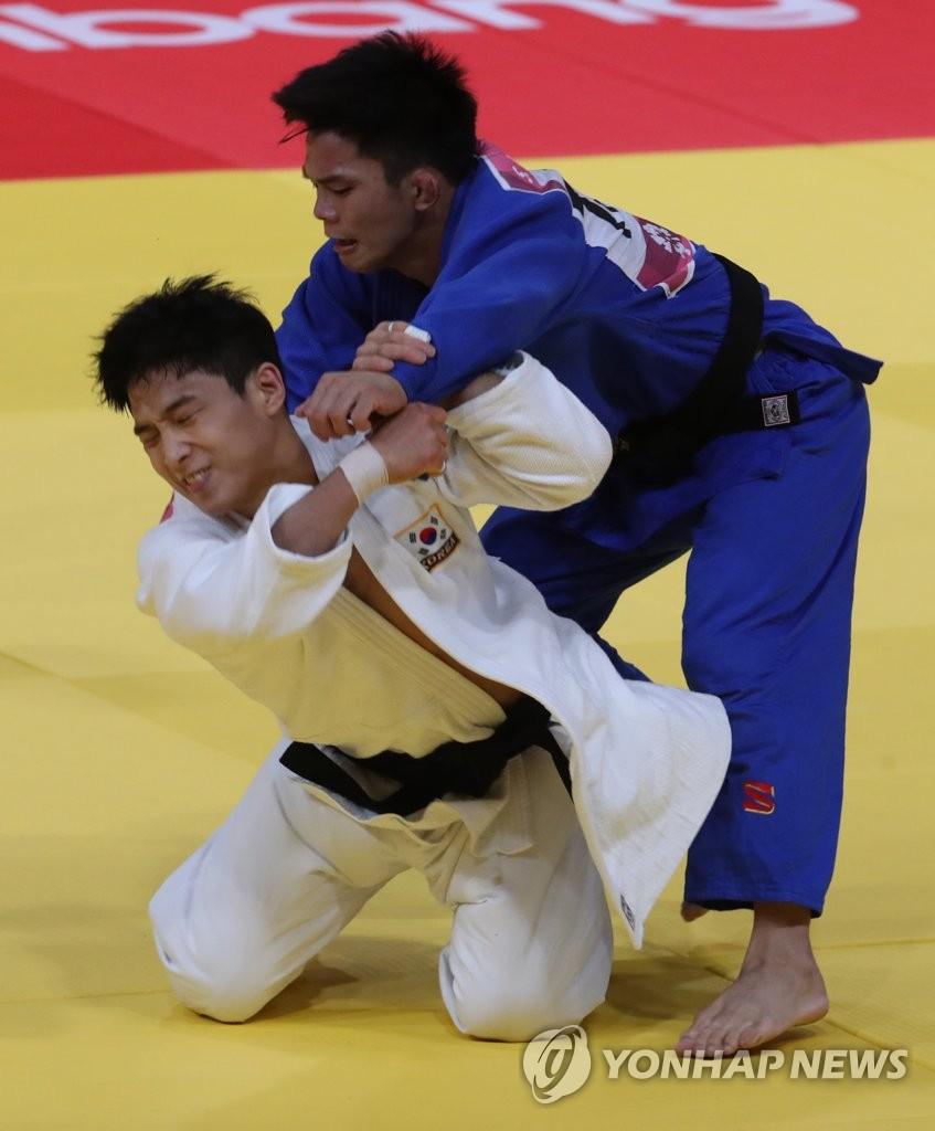 亚运柔道男子66公斤韩国安保罗摘金