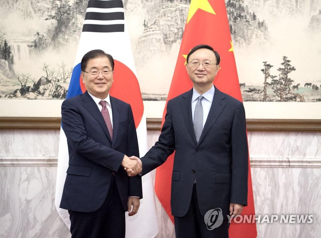 郑义溶在华会晤杨洁篪介绍特使团访朝成果