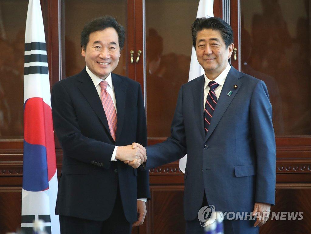 韩日总理会晤 安倍称有意改善朝日关系