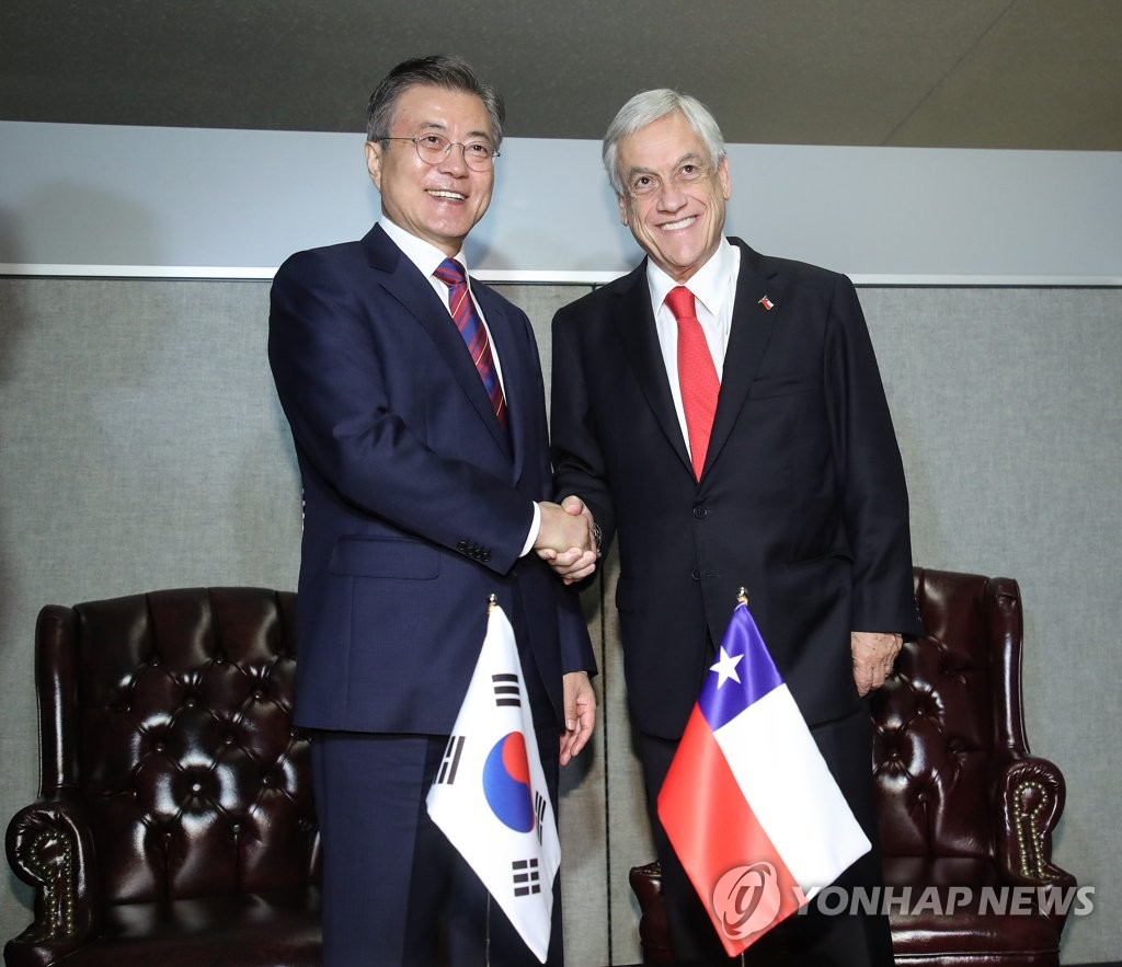 智利总统访韩明会晤文在寅