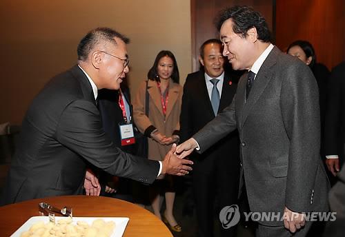 现代三星高管在首尔会中国国务委员王勇