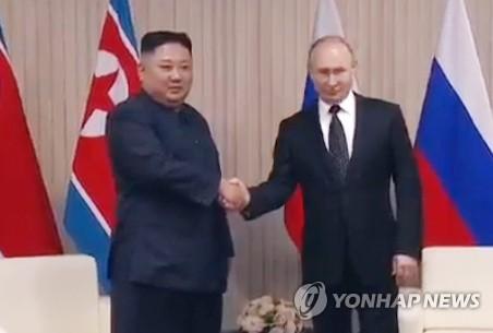 朝俄领导人握手