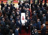详讯:韩前总统金大中夫人李姬镐追悼会举行