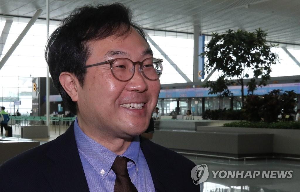 韩国对朝代表李度勋明访华会见中国副外长罗照辉