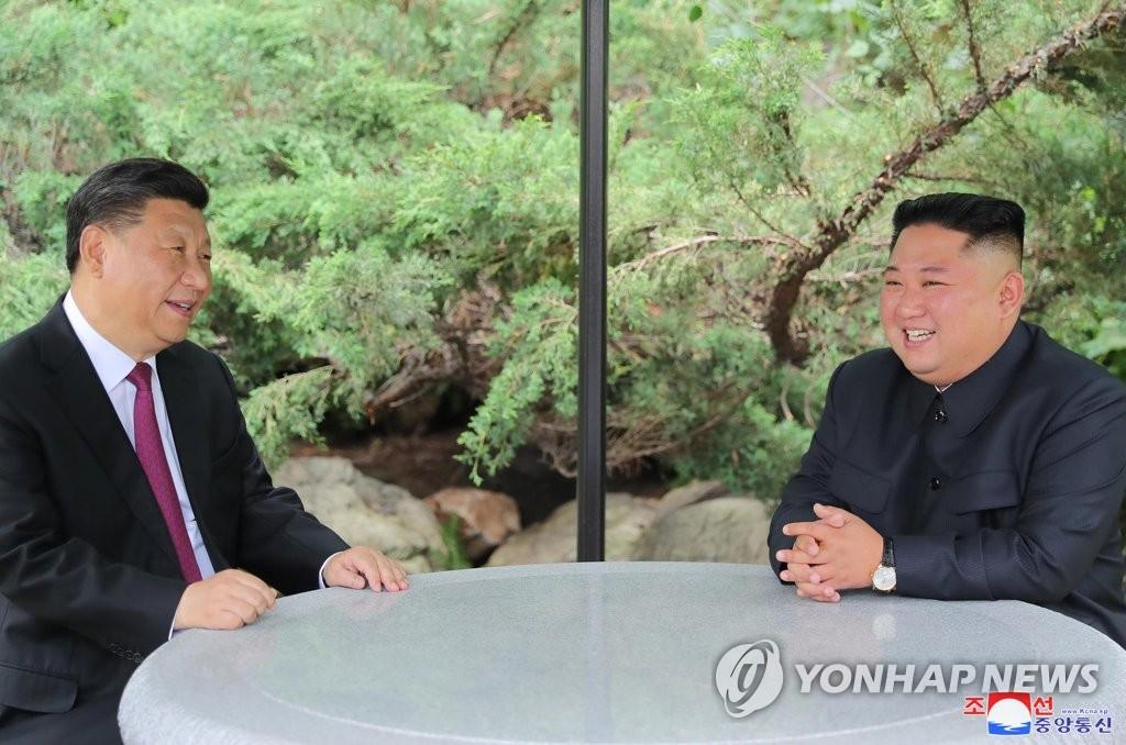朝中举办座谈会纪念领导人互访