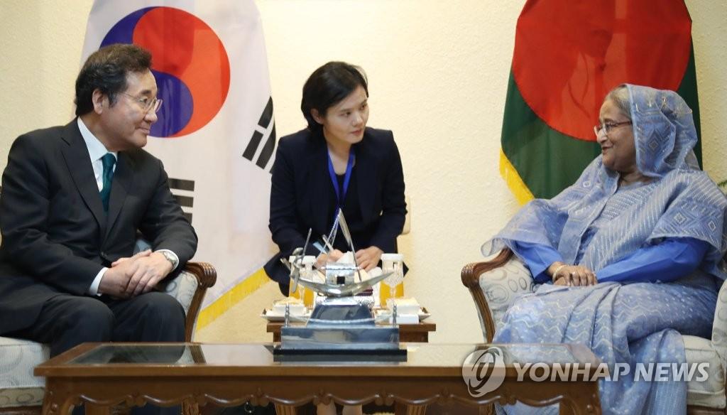 韩孟总理举行会谈共商合作大计