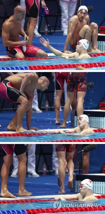 7月26日,在光州世游赛男子4x200米自由泳接力预赛中,游完第三棒的孙杨到池边向巴西选手卢卡伸手,但卢卡拒绝握手起身离去。 韩联社