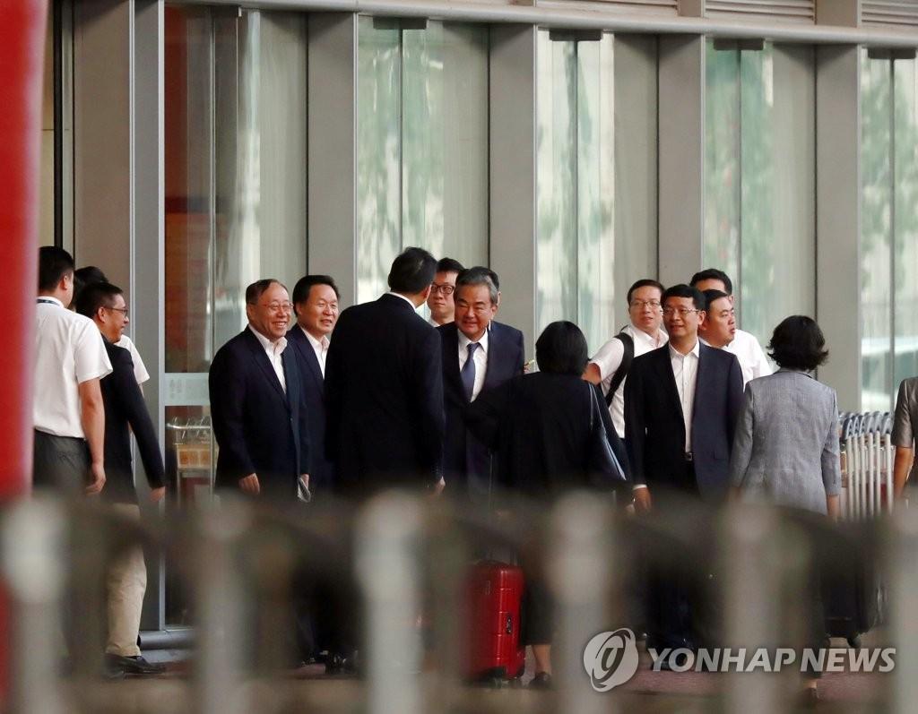 朝媒报道李洙墉会见中国外长王毅消息
