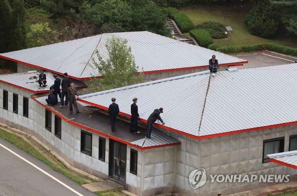 韩朝美合力开展灾后复建