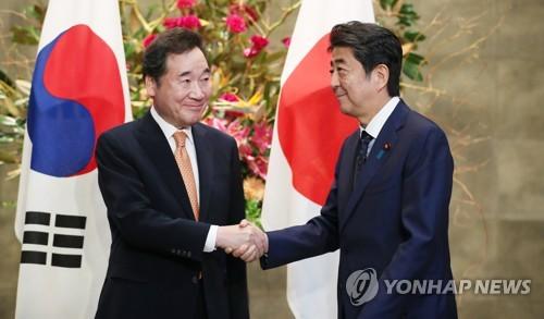 韩国总理李洛渊结束日本之行回国