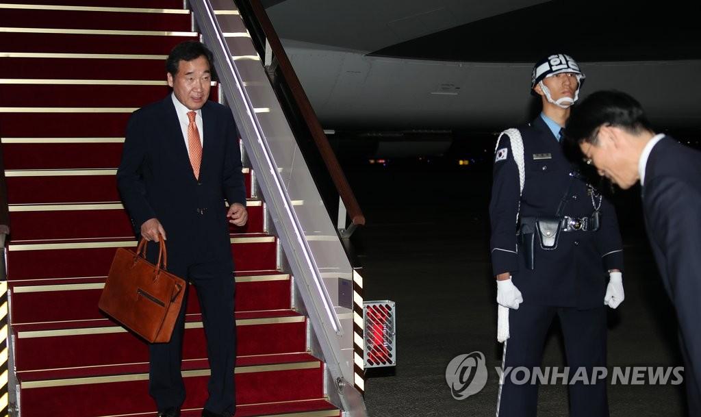 10月24日,李洛渊结束日本之行,抵达首尔机场。 韩联社