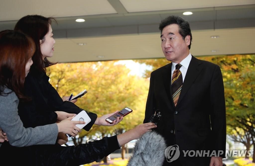 李洛渊接受采访 韩联社