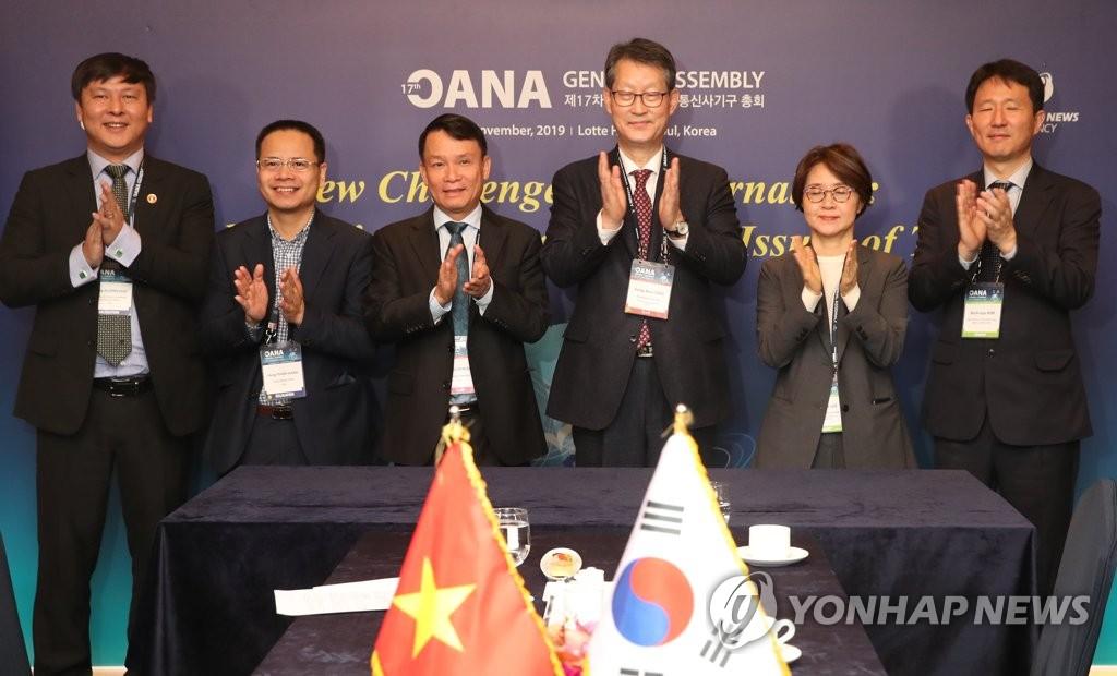 韩联社社长会见越南通讯社社长