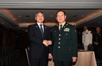 韩中防长在泰国举行会谈