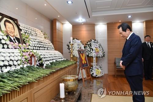 韩总理丁世均吊唁辛格浩