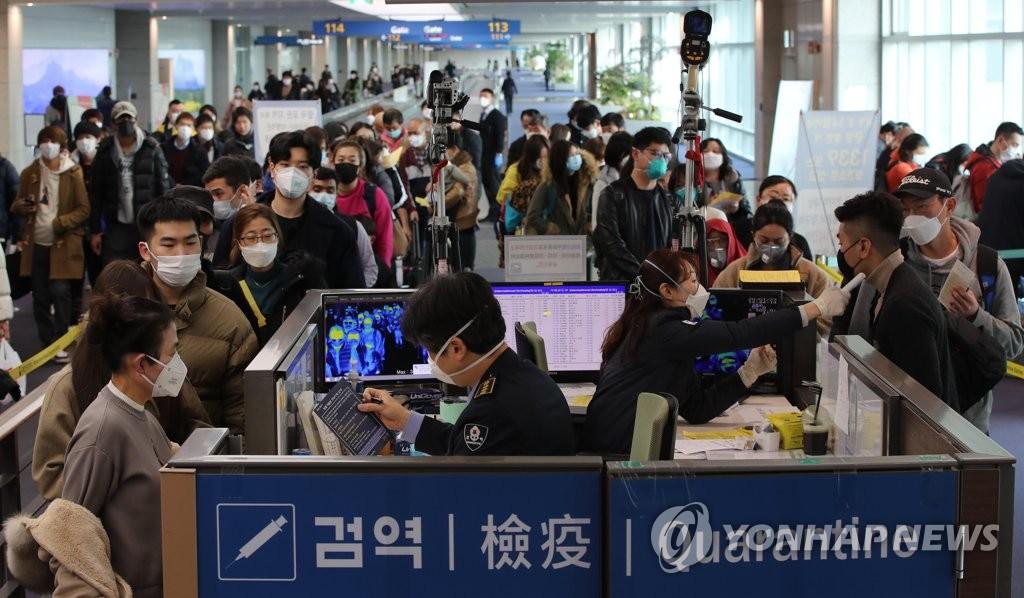 韩国公民撤离武汉回国后将被隔离14天