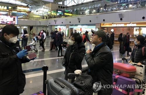 滞留北京韩国公民明乘包机回国