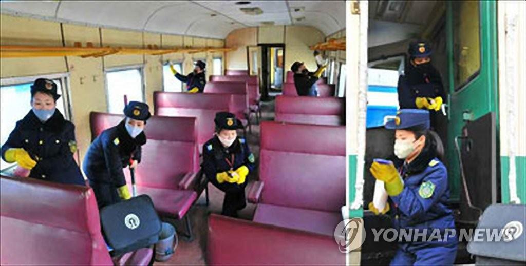 """资料图片:朝鲜《劳动新闻》2月18日援引""""应急中央人民保健指导委员会""""干部的话报道称,截至目前朝鲜没有出现任何新冠病毒(COVID-19)感染病例。图为工作人员进行消毒防疫。 韩联社/《劳动新闻》官网截图(图片仅限韩国国内使用,严禁转载复制)"""