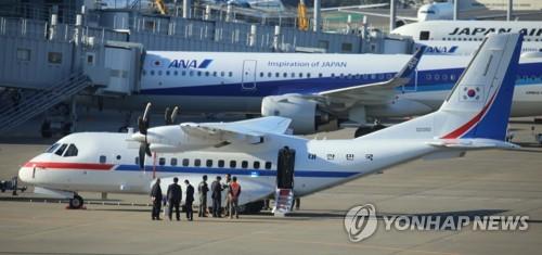韩总统专机飞抵东京羽田机场