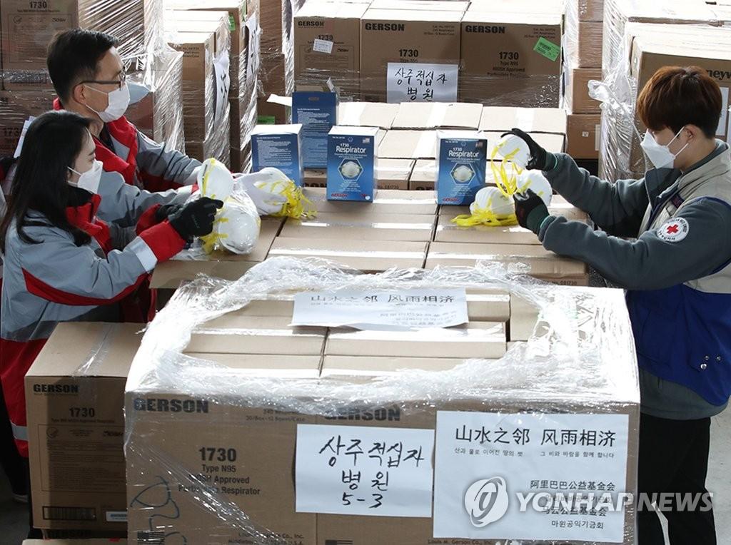 韩中明举行新冠视频会议商讨抗疫合作