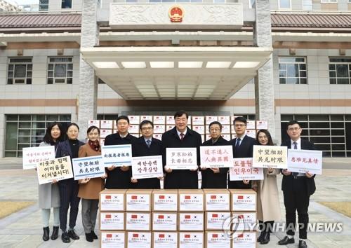 韩中开新冠视频会议商定加强抗疫合作