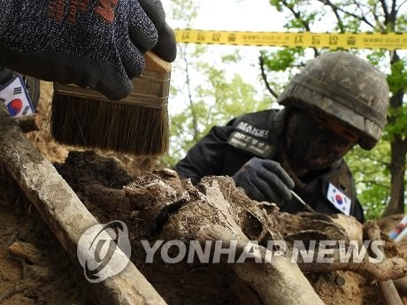 韩军今暂停非军事区韩战遗骸发掘工作