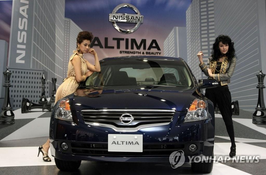 资料图片:2009年日产新车发布会现场 韩联社