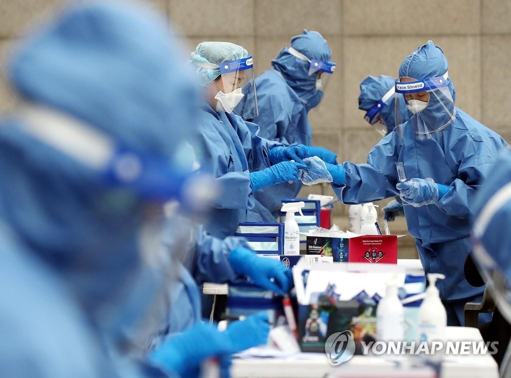 资料图片:韩国仁川市富平区的一筛查诊所 韩联社