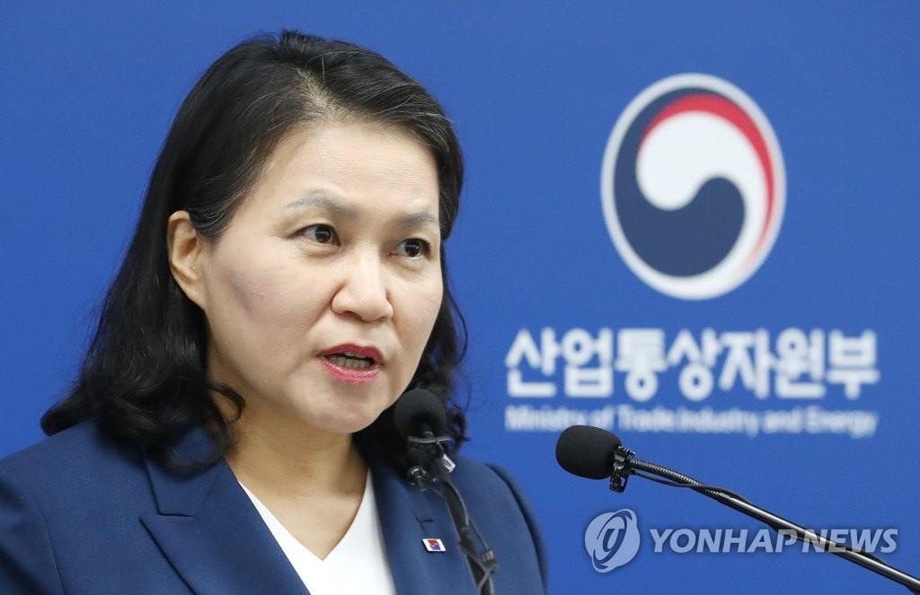 资料图片:6月24日上午,在中央政府世宗办公楼,俞明希开记者会宣布参选世贸组织总干事。 韩联社