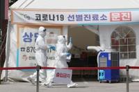 韩国防疫内外吃紧 持久战成定局