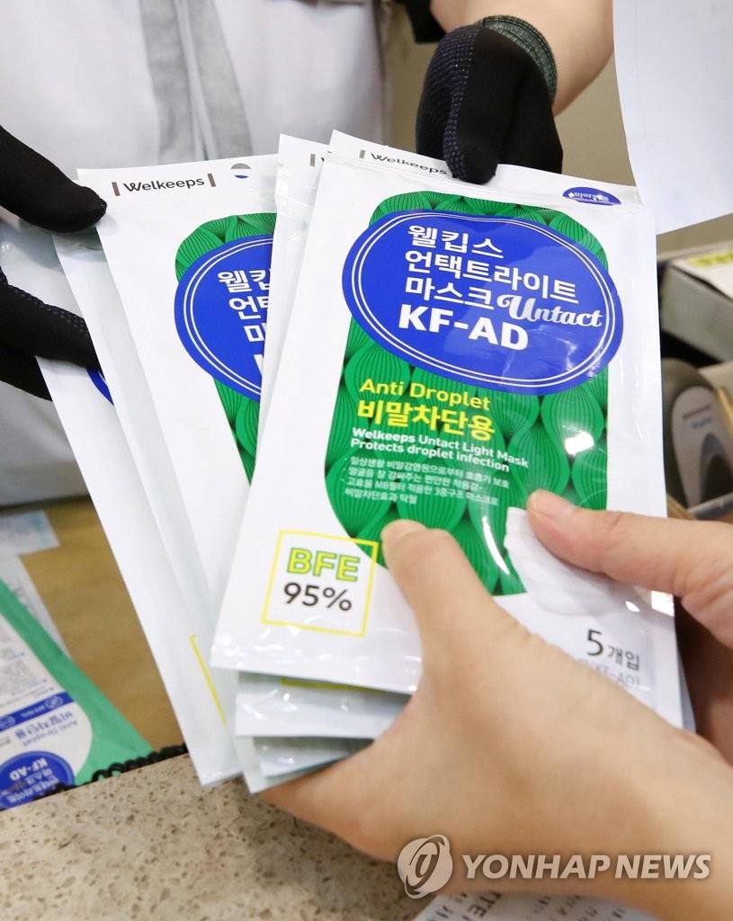 韩政府拟进一步解禁口罩出口