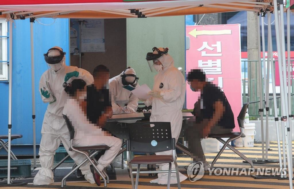 韩国近两周感染途径不明病例占24%创新高