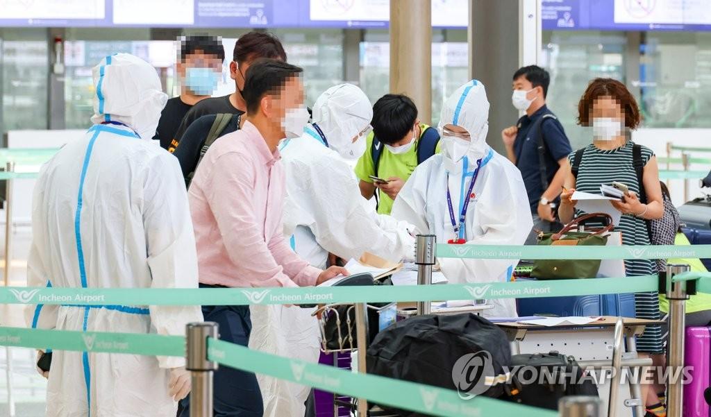 资料图片:韩企人士经快捷通道赴华。 韩联社