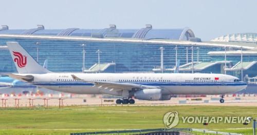 韩增飞大批包机送侨返华