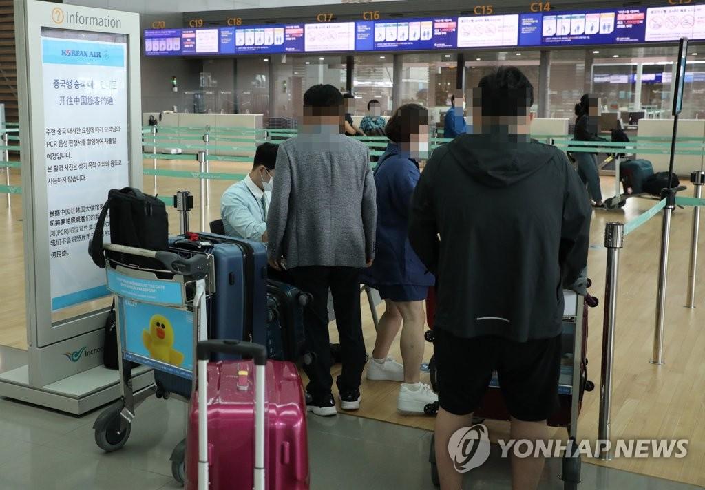 韩侨乘临时航班返华