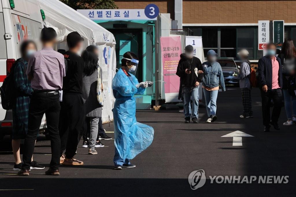 韩政府:保持社交距离奏效 双重疫情可防可控
