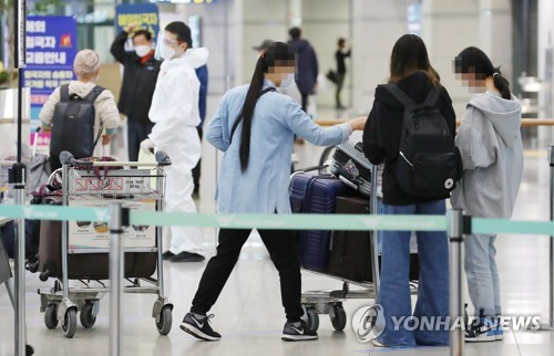 自韩赴华乘客明起登机前须提交两份新冠阴性证明