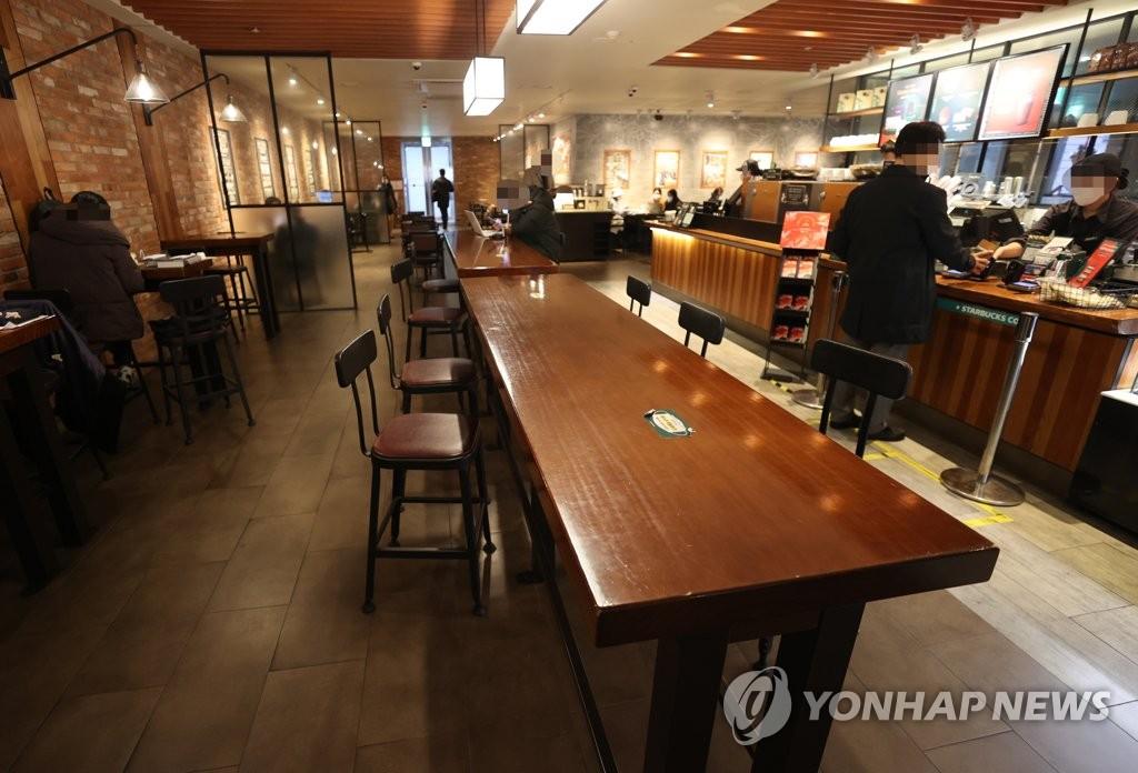 资料图片:首尔市区一家咖啡厅 韩联社