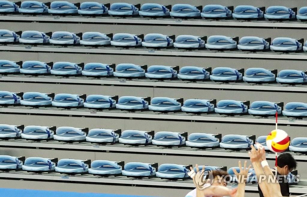 资料图片:疫情下体育赛事零观众开赛。 韩联社