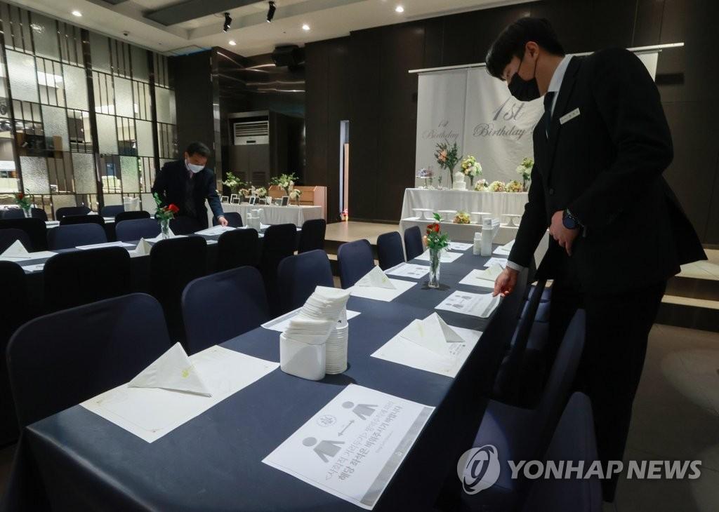 韩政府明起延长现行防疫响应级别至28日