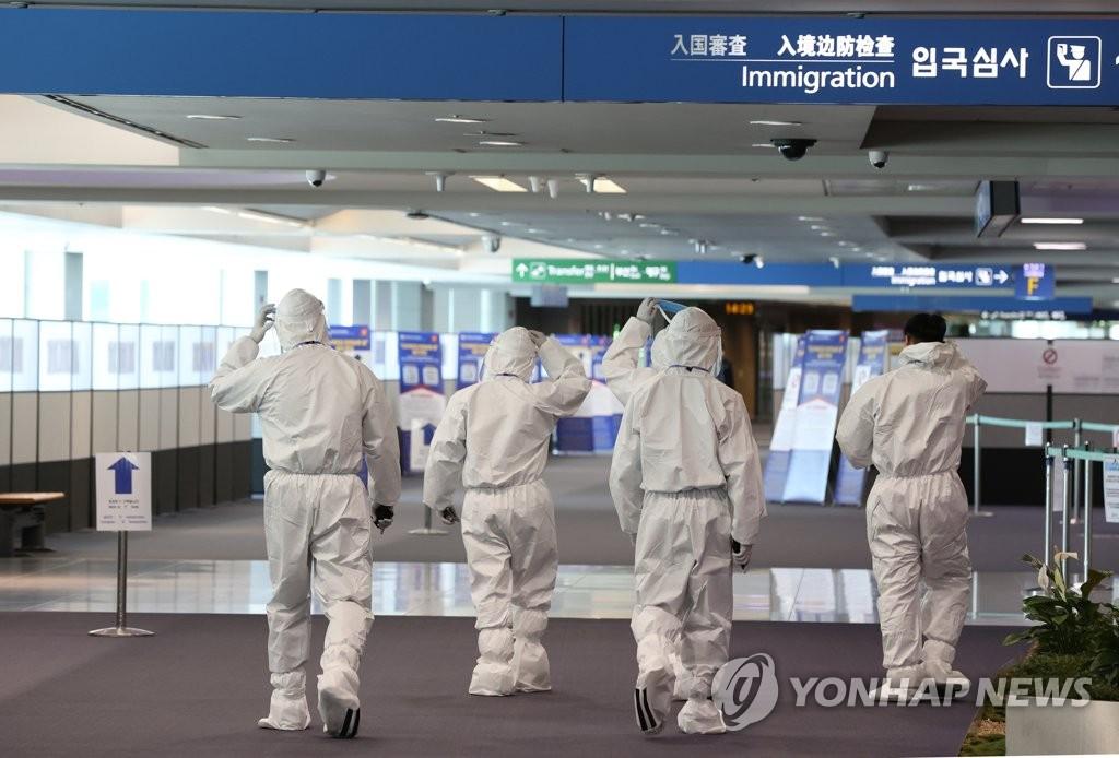 资料图片:仁川机场入境检疫区 韩联社