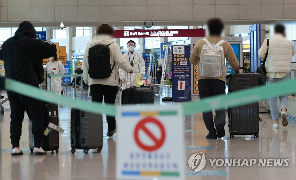 资料图片:海外入境人员 韩联社