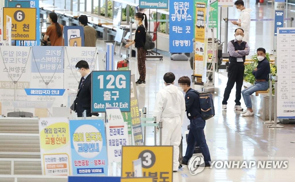 资料图片:机场检疫 韩联社