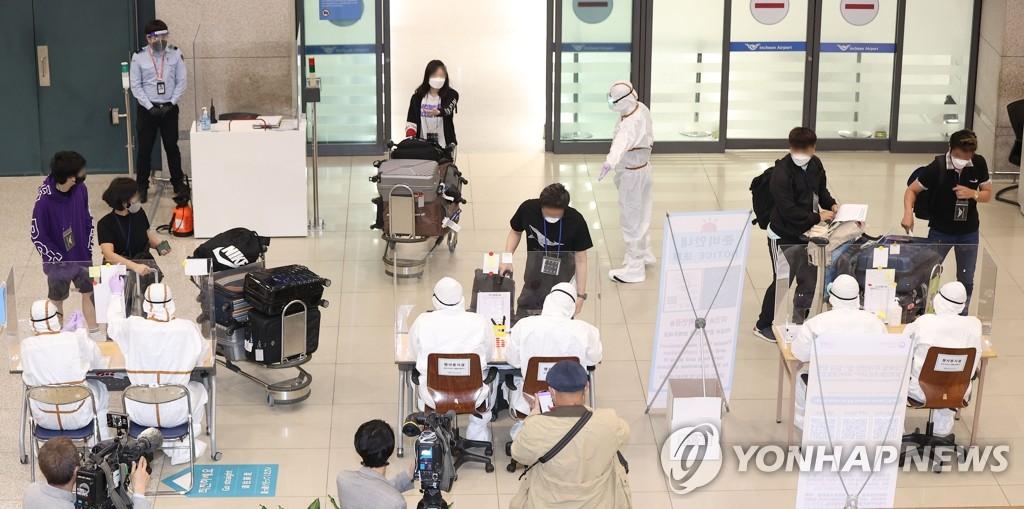 详讯:旅印韩侨首批172人乘机回国