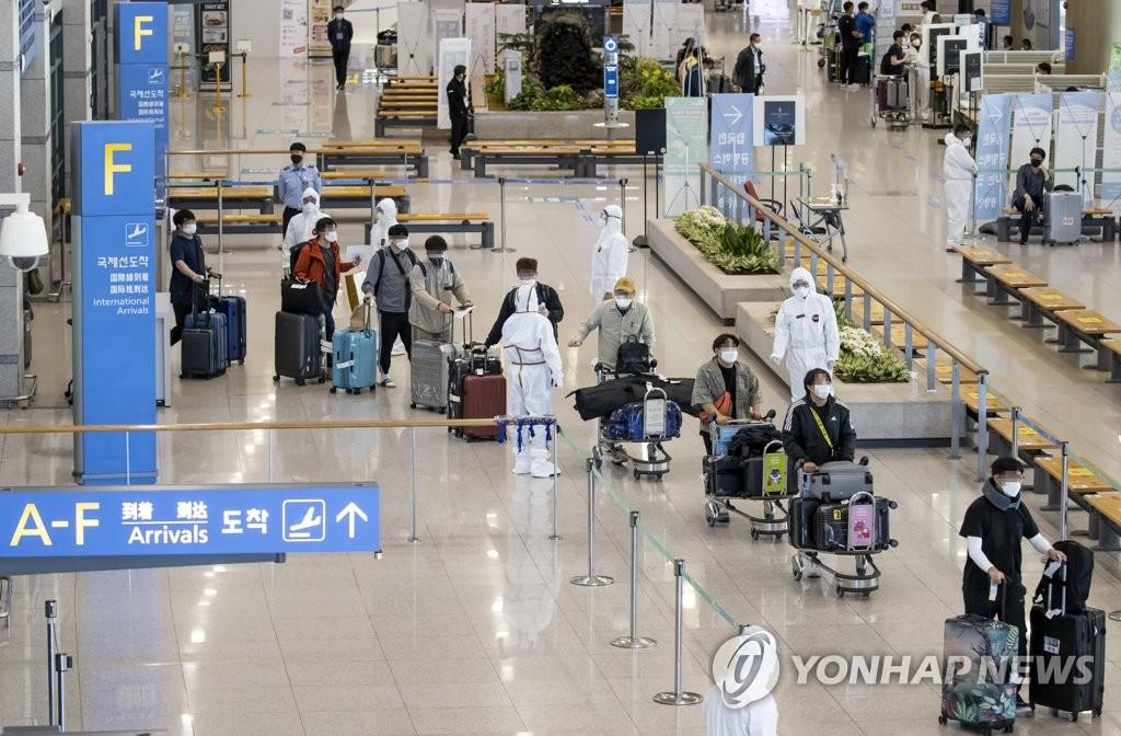 自印撤离韩企员工抵韩