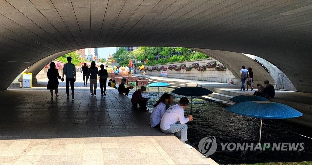 韩多地今日气温如初夏升至30度