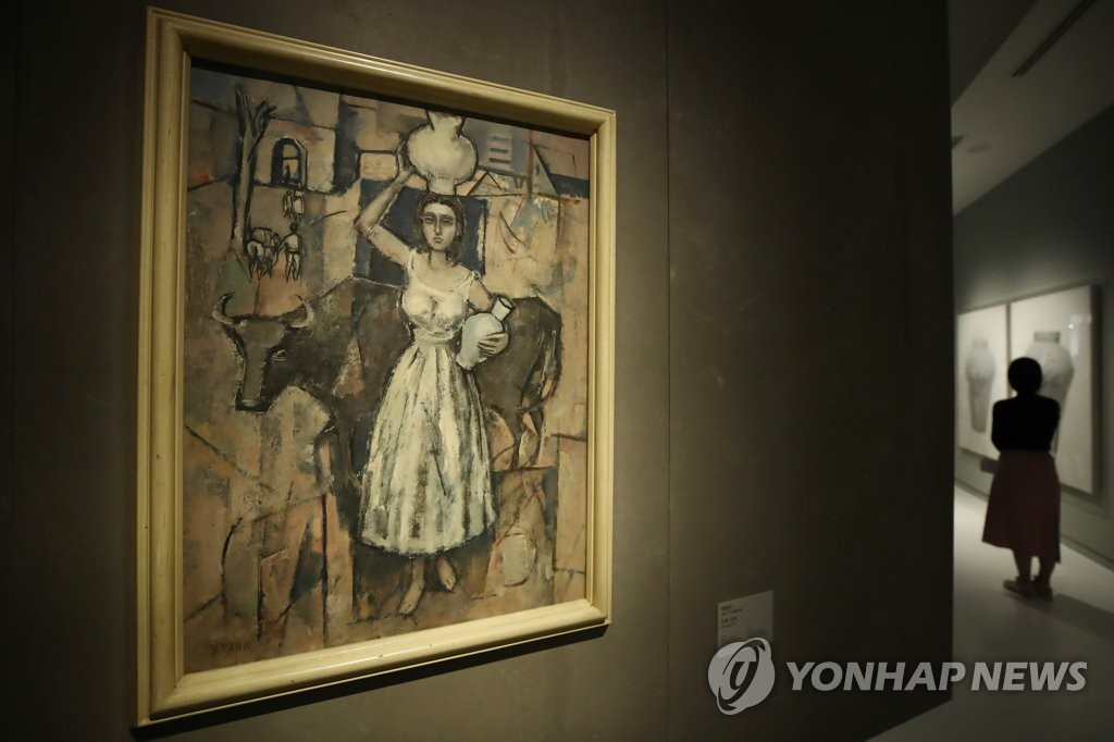 资料图片:李健熙生前收藏画作《牛与少女》 韩联社