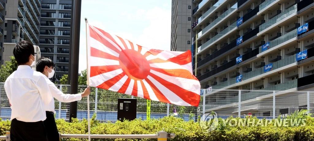 日本人举军旗挑衅韩国奥运代表团