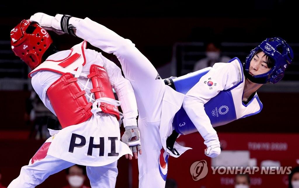 韩跆拳道选手张准夺东奥男子58公斤级铜牌
