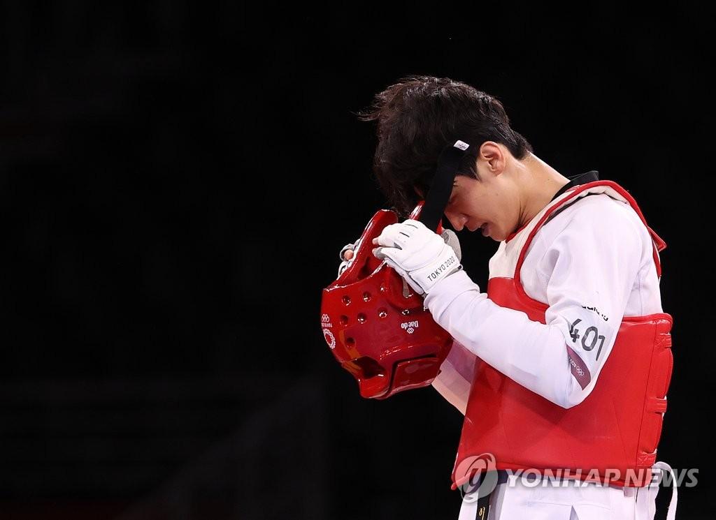 7月25日,在日本幕张展览馆A厅举行的东京奥运会跆拳道项目男子68公斤级铜牌争夺赛上,韩国选手李大勋惜败。 韩联社